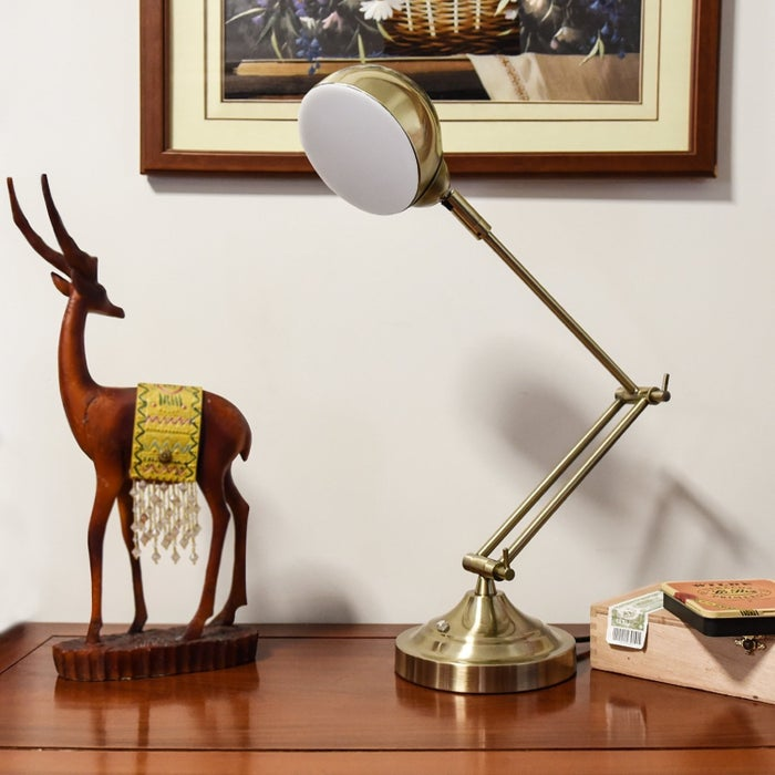 """Promising review: """"I have had this lamp for about a week now and so far I am super happy with it. The whole lamp is very elegant with an antique copper color. The head and arm are adjustable, which allow you to find the perfect height and angle. No lightbulb is needed. The LED lamp is bright, and the brightness can be tuned easily through the sensory button. The whole lamp is really amazing and i am highly recommend it!"""" —OliviaPrice: $43.99"""