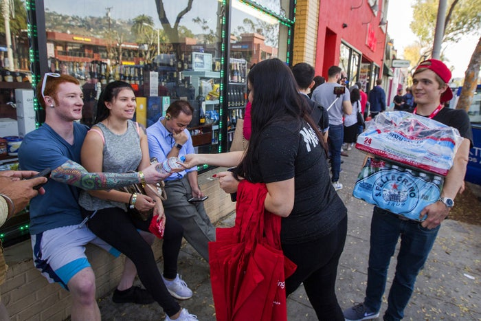 MedMen employees give water to people waiting in line on Jan. 2.