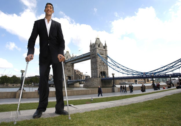 Kosen, a farmer from Turkey, was named the tallest living man in the world by Guinness World Records in February 2011. He also holds the record for the world's largest hands, (11.22 inches from his wrist to the tip of his middle finger).