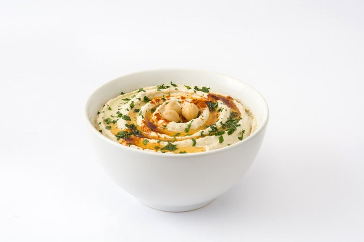 Hands down the creamiest and most addictive hummus recipe you'll ever try (The magic is in the tahini). Recipe here.