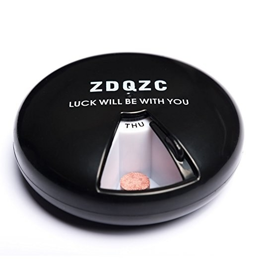 This compact pill dispenser that is delightfully simple.