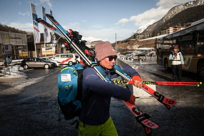 """Sajjad Husaini heads back to the car after a trial race was canceled due to bad weather. """"It's disappointing when a race gets canceled,"""" he says, """"the more races we participate in, the bigger are our chances of reaching the right amount of points for the Olympics."""""""