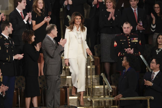After arriving separately, people on social media noted that the first lady's stark, all-white Christian Dior pantsuit resembled the two dozen women musicians who dressed in white during last Sunday's Grammy Awards for a powerful performance in support of the #MeToo movement.