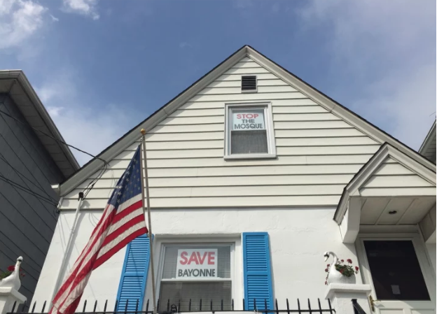 A home in Bayonne, New Jersey, with signs against the proposed Muslim community center.