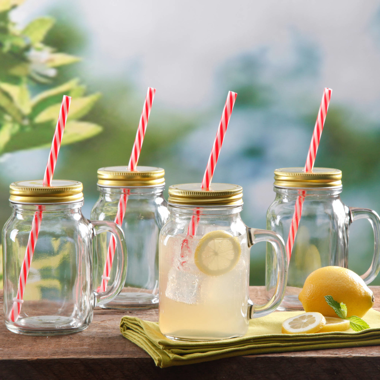 The mason jar drinking glasses with straws in them