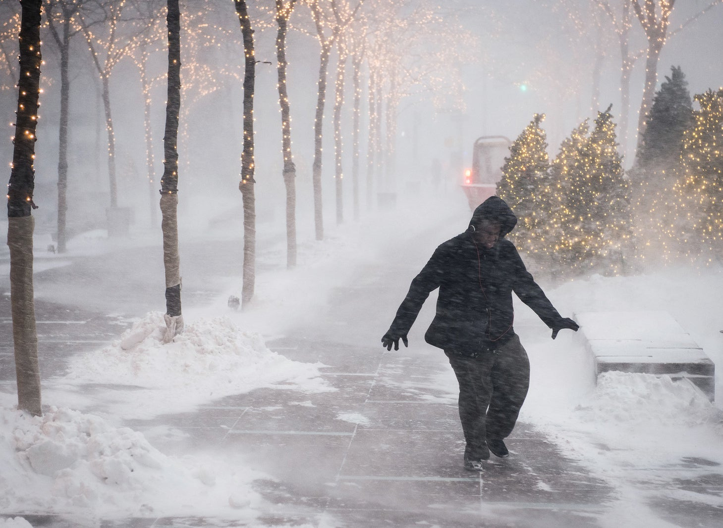 A pedestrian walks in strong winds in New York City.