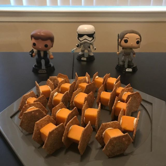 These adorable tie fighters can be made with just crackers, cheese cubes, and cream cheese.