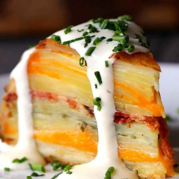 8 servingsINGREDIENTS7  red potato, medium2 teaspoons salt1 teaspoon black pepper480 mL (2 cups) heavy cream2 tablespoons butter, softened8  yukon gold potato, medium or large10 slices cheddar cheese6 strips bacon, cooked until crispy10 g (1/4 cup) chives, finely chopped plus more to serve1 sheet puff pastry, cut into a 9-inch circle1 teaspoon onion powder1 teaspoon garlic28 g (1/4 cup) grated parmesan cheesePREPARATION1. Preheat oven to 350°F (180°C).2. Using a mandolin, slice the red potatoes to about 3 millimeter-thick slices.3. Slice the gold potatoes to about 5-6 millimeters thick.4. In a large bowl, combine the red potatoes with the salt, pepper, and heavy cream, and stir until evenly coated.5. Butter an oven-safe, 8 or 9-inch, stainless steel mixing bowl.6. Starting from the center, lay the red potatoes in an overlapping, circular fashion, making sure they make good contact and are sticking to the bowl. Repeat the circular pattern up until roughly ½-inch from the top of the bowl.7. Place the sliced gold potatoes into the cream, stirring until fully coated with cream.8. Shake off the excess cream, then layer the potato slices at the bottom of the bowl, building in a similar circular fashion.9. After 2-3 rotations, place down 2 slices of cheddar. To fill the gaps, you might need to cut 2 more slices into halves and use those strips near the edges.10. Layer another 2 rotations of gold potatoes.11. Place the strips of bacon in a single layer across the potatoes.12. Layer another 2 rotations of gold potatoes.13. Sprinkle the chives in an even layer across the potatoes.14. Layer another 2 rotations of gold potatoes.15. Fan out the rest of the cheddar slices in a circular pattern on top of the potatoes.16. Layer another 2 rotations of gold potatoes.17. Place the circle of puff pastry on top, pressing it lightly into the potatoes.18. Bake, uncovered, for 1 hour and 30 minutes. If the pastry or the edges of potatoes near the top are starting to get too dark, cover the