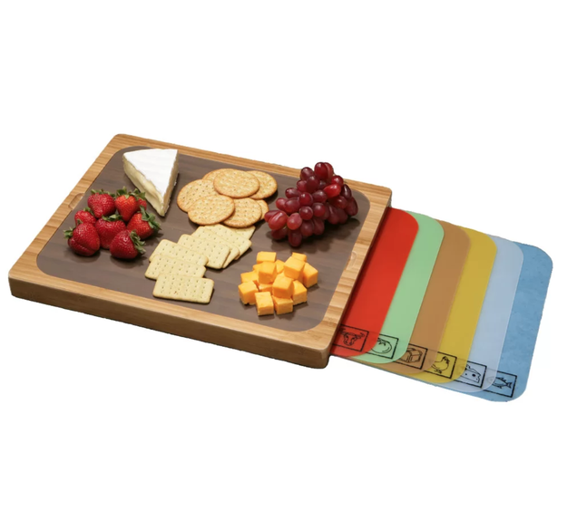 An easy-to-clean bamboo cutting board that holds seven (!) of its own color-coded cutting mats.