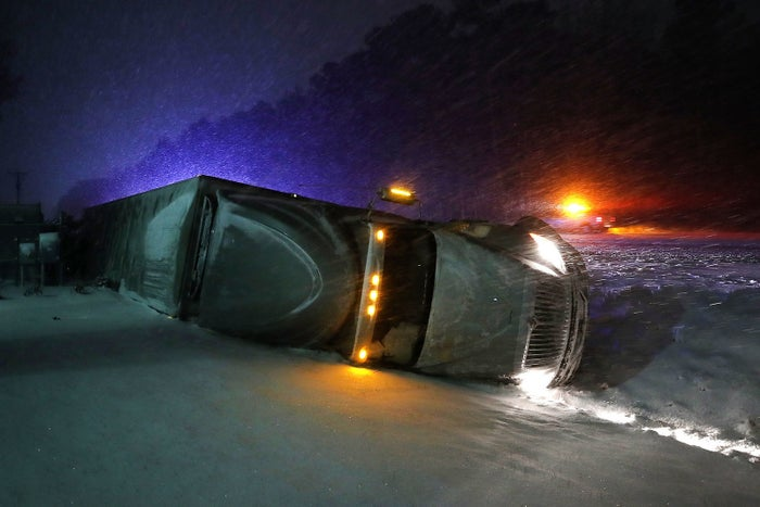 A tractor trailer after running off the road during a snow storm on Jan. 4, in Georgetown, Delaware.