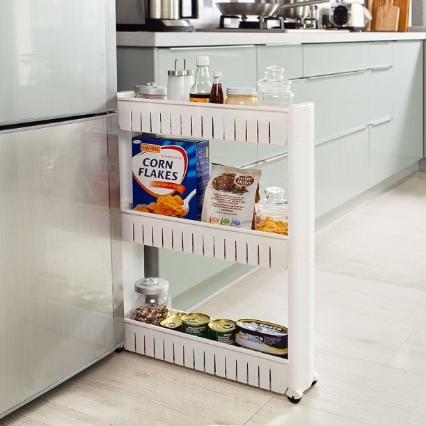 This slim slide-out kitchen tower for maximum storage points.