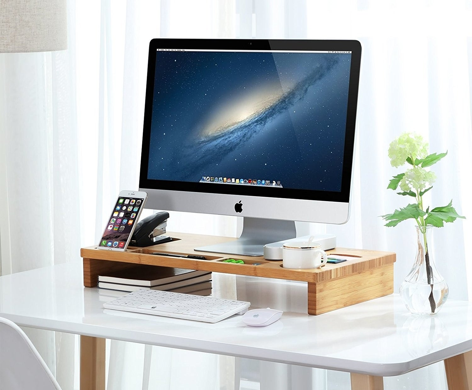 "Promising review: ""I absolutely LOVE this monitor stand. It has all the cubby holes I need for the things I typically use at my desk. It keeps my desk looking organized, and it's easy to grab things because everything is all right there."" —Sharing Life's MomentsGet it from Amazon for $29.99+ (available in three colors)."