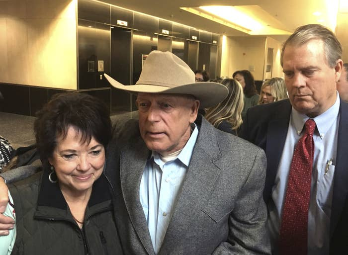 Cliven Bundy, center, emerges from court on Monday a free man, flanked by his wife, Carol Bundy, left, and attorney Bret Whipple.