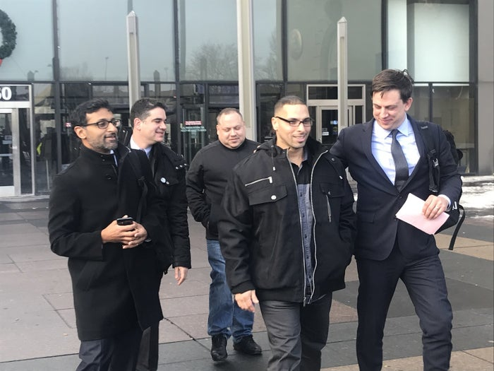 Thomas Sierra, second from right, after his conviction was dismissed.