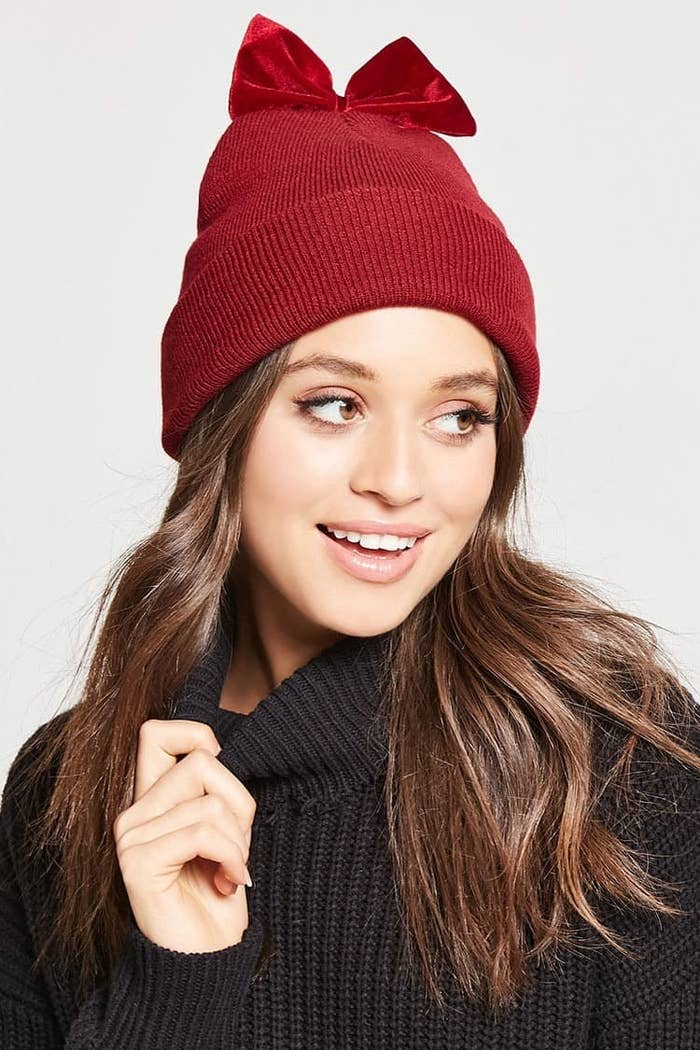 259834e84c99c A velvet bow beanie for showing a sweet side even when you re cursing the  wind under your breath. Get it from Forever 21 ...