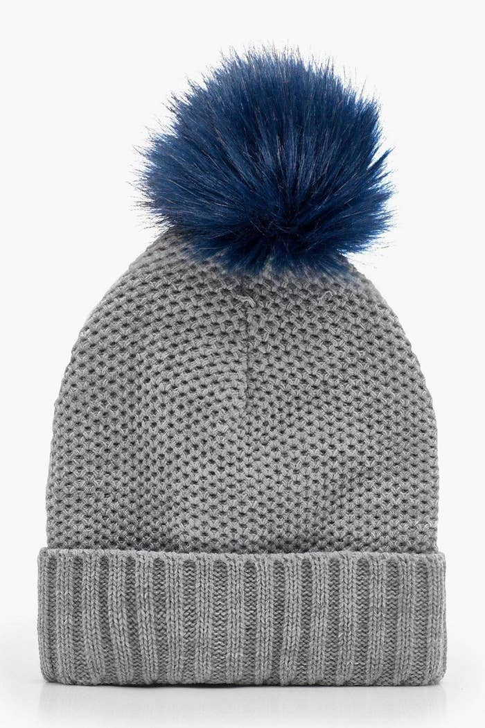1c47c3bb407 A beanie with a contrast pom for holding you over until blue skies return.
