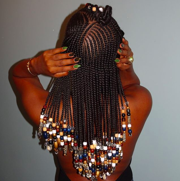 It has taken on many variations as black women all over the globe have adopted the style, but there are some common characteristics, like bead accents, that've remained popular.