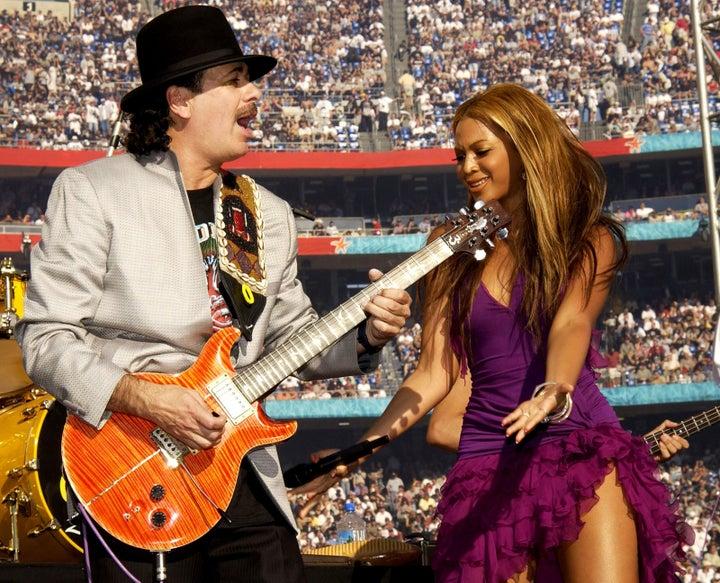 Jan. 26, 2003 — Carlos Santana and Beyoncé at Super Bowl XXXVII in San Diego