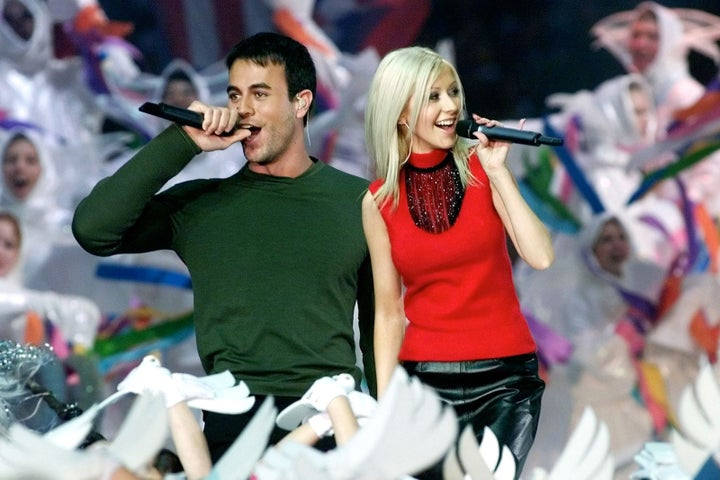 Jan. 30, 2000 — Christina Aguilera and Enrique Iglesias at Super Bowl XXXIV in Atlanta