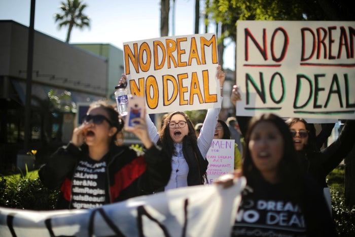 DACA recipients and supporters protest for a clean DREAM Act.