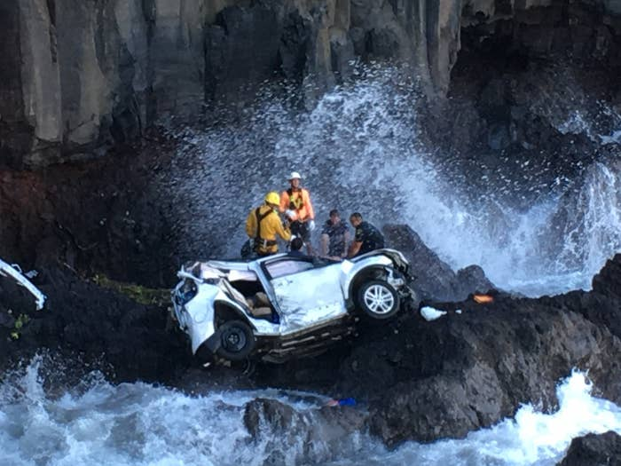 Rescuers work to extricate the two women from the SUV that drove off a cliff in Maui in May 2016.