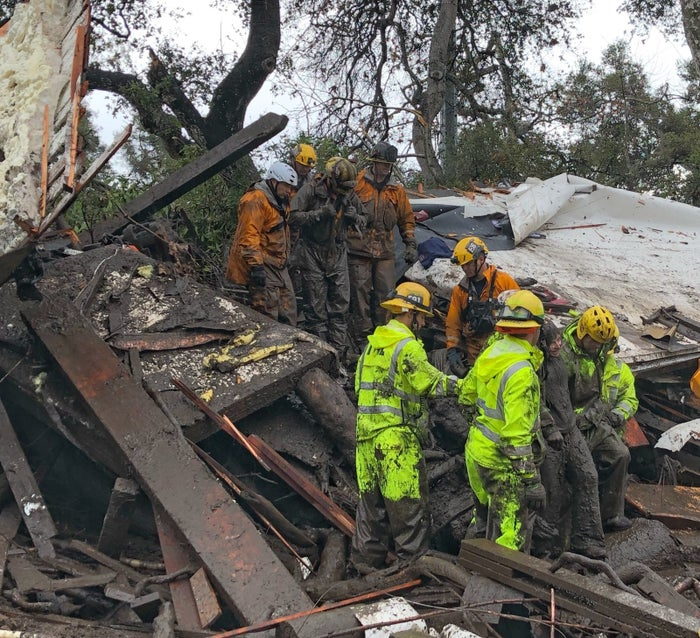 Firefighters rescue a 14-year-old girl trapped inside a home as mudslides swept into Montecito, California.