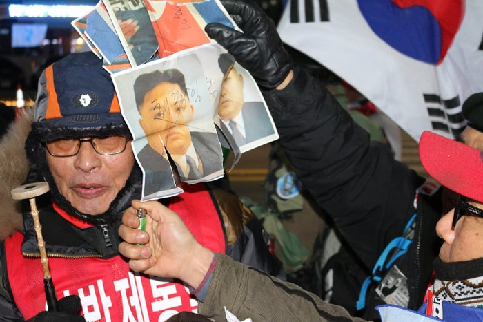 Nam In-soo, the president of the conservative anti–Korean unification group Freedom Korea National Defense Corps, outside of the Pyeongchang Olympic Stadium Friday night.