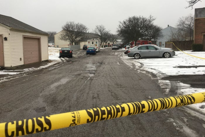 Police tape cordons off the area where two Westerville, Ohio, police officers were shot and killed responding to a hang-up 911 call on Saturday.