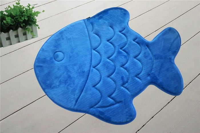 """It's technically for kids, but you're totally getting one for yourself. Promising review: """"This is the cutest bath mat. It truly is the softest bath mat I have ever had. It's also true to size and perfect for my boys' bathroom."""" —SaraPrice: $17.99"""