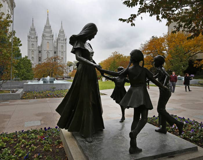 A statue of a mother and her children near the World Headquarters of the Church of Jesus Christ of Latter-Day Saints in Salt Lake City, Utah.