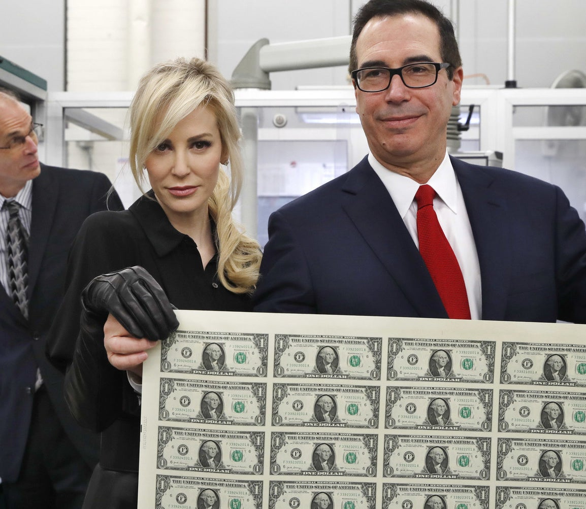 She's married to Treasury Secretary Steven Mnuchin. One time, they posed with a sheet of money like a couple of fancy Disney villains.
