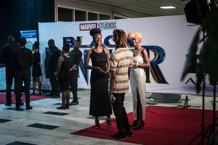 Moviegoers relax on the red carpet ahead of the premiere of Black Panther in Kisumu, Kenya, on Feb. 13.
