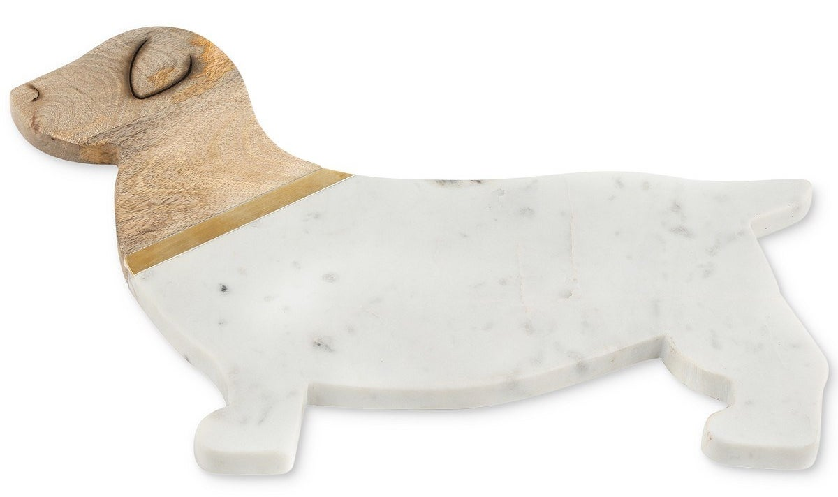 A pup-shaped serving board made from acacia wood and marble that's easy to wipe clean.