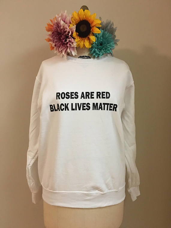 """People started asking Mieko to sell t-shirts featuring the viral poems, so she eventually pitched a collab to Olatiwa after spotting the designer's sweatshirts online. """"I thought they were really cool, so I researched her,"""" the writer said. """"I was excited to partner with another black femme, especially someone who had a good sense of style and ethics."""""""