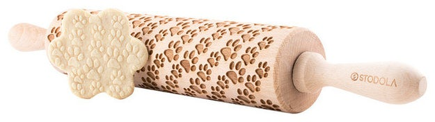 An engraved wooden rolling pin so your cookies can have fun 3D puppy tracks.