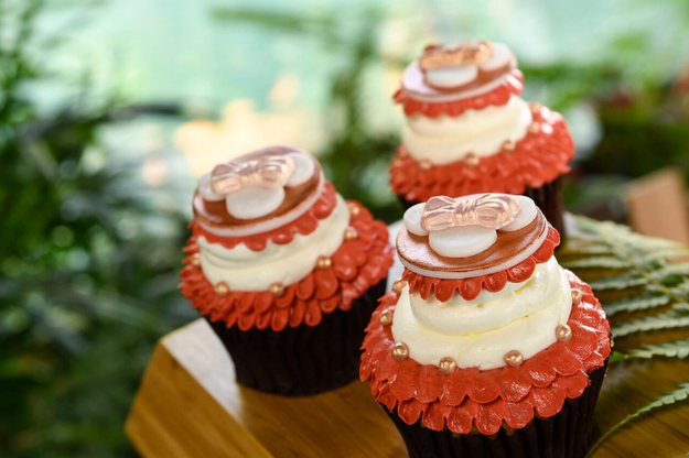 This island-inspired Rose Gold Vanilla Cupcake with guava pastry cream.