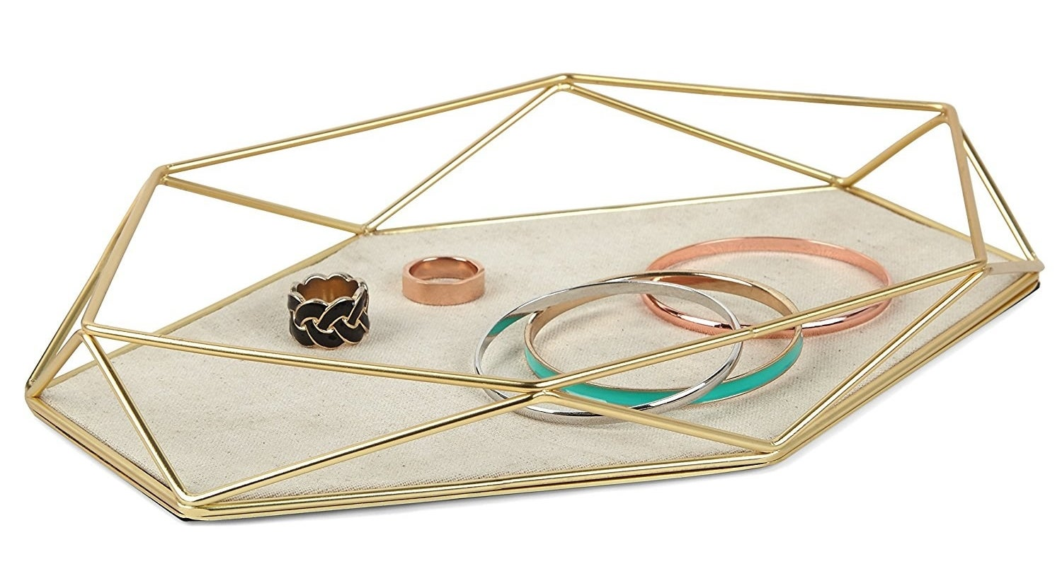 The hexagon shaped tray with gold tone geometric design walls