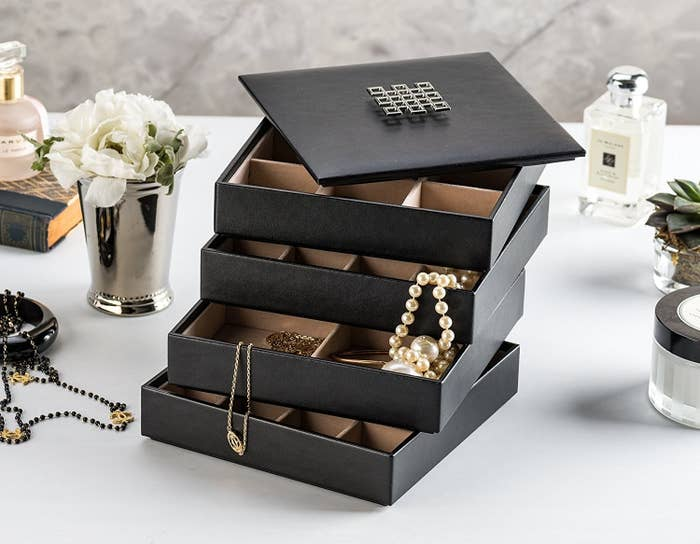 "Promising review: ""I bought two of these jewelry boxes to hold overflow items from my other jewelry boxes and jewelry wardrobe. These stackable trays are beautifully made and look attractive anywhere they are set. I will definitely order again if I need more."" —Star ChildGet a set of four from Amazon for $29.95."