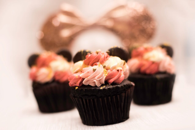 For chocolate fans, this Rose Gold Chocolate Cupcake with strawberry buttercream filling and topping, chocolate ears, and chocolate crispy pearls.