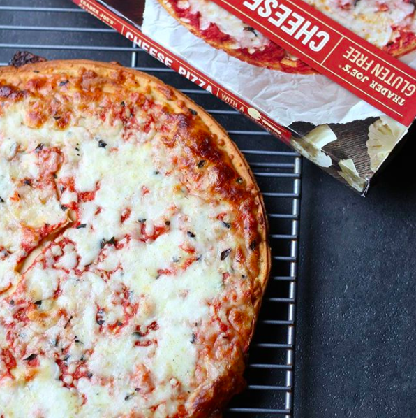 This Trader Joe's gluten-free cheese pizza with cauliflower crust, so you can get a tasty dinner on the table in about ten minutes.