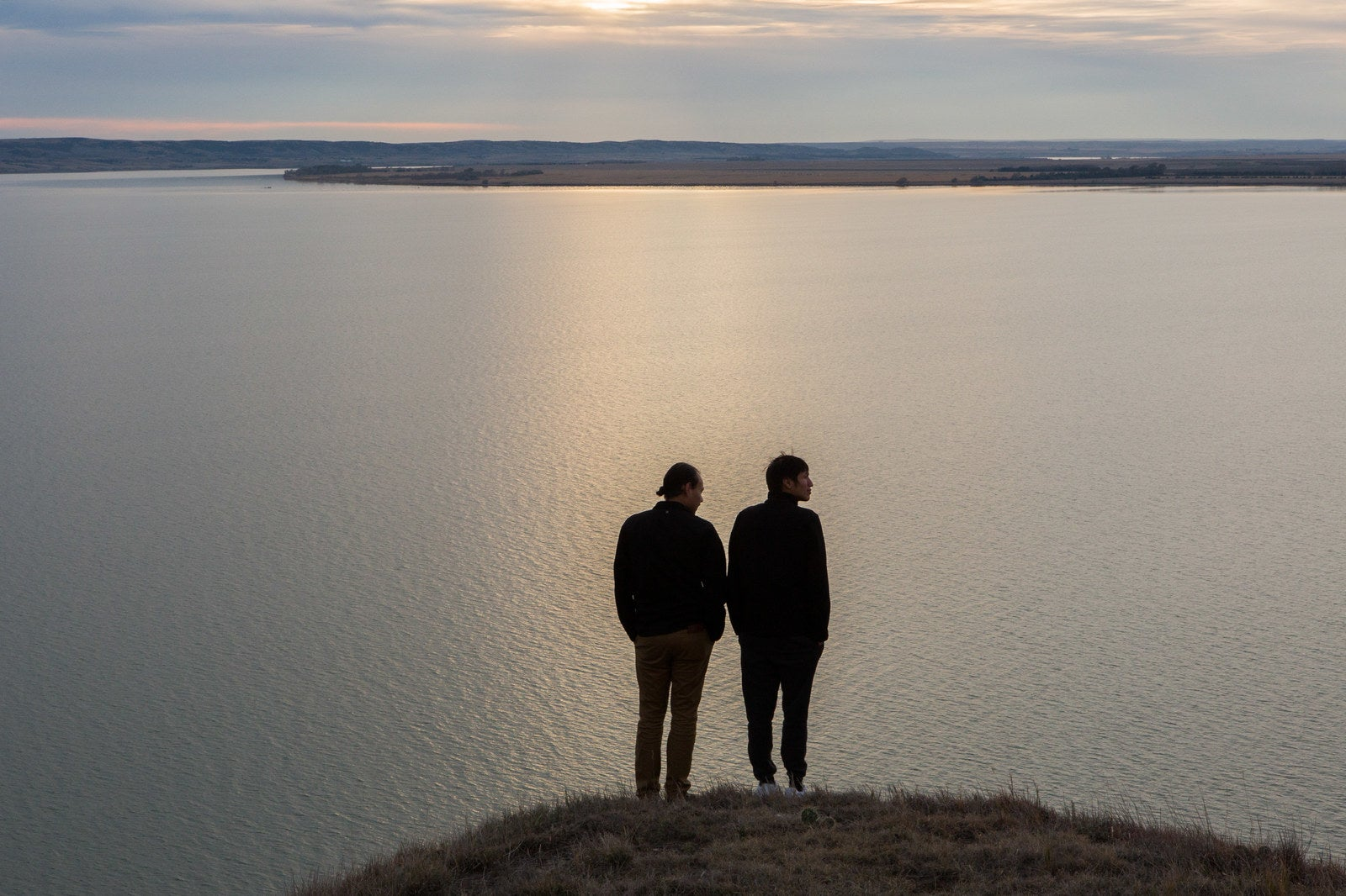 Joseph White Eyes and Danny Grassrope stand on a bluff overlooking the Missouri River on the Lower Brule Reservation in South Dakota on Nov. 8, 2017. Grassrope grew up in Lower Brule and returned there with White Eyes after the #NoDAPL camps in Standing Rock were evicted in early 2017. Grassrope and White Eyes are now working as environmental activists in Lower Brule and beyond.