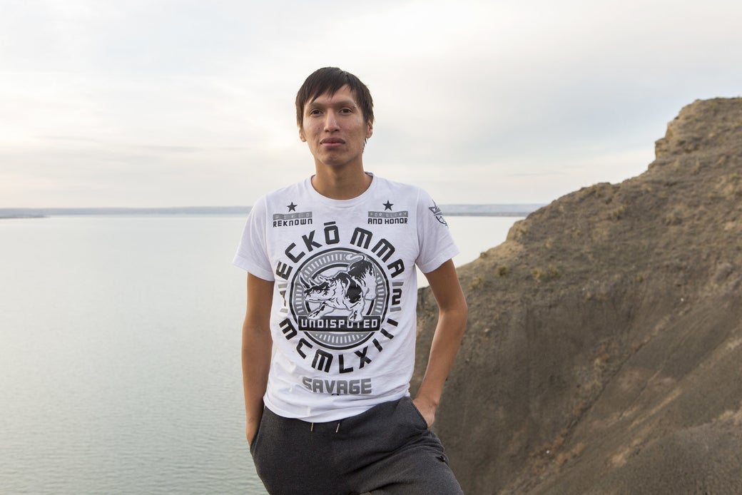 Danny Grassrope stands on a bluff overlooking the Missouri River on the Lower Brule Reservation in South Dakota.