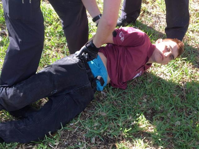 Nikolas Cruz is taken into police custody Wednesday after the school shooting.