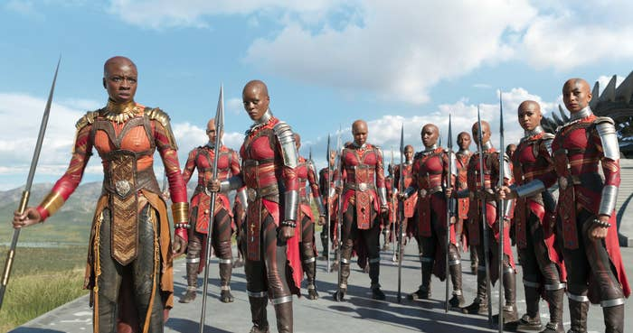 """Certainly one of the most beautiful scenes of the film happens when a father tells his son, """"get up – you're a king."""" Some rhetoric suggest a different way of living for blacks – especially those in Africa. One of the best things about Black Panther is its ability to show black royalty. This gives black children a new face, one that they don't often get to see. In this action film, they weren't the funny best friend or the sassy homegirl. They were Kings and Queens."""