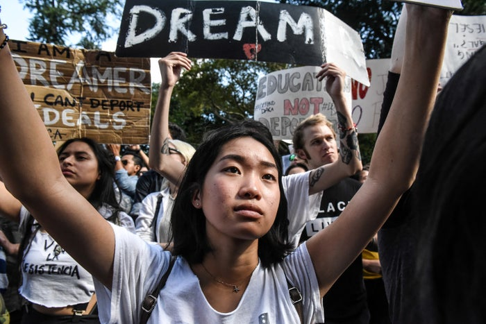 People participate in a protest in defense of DACA.