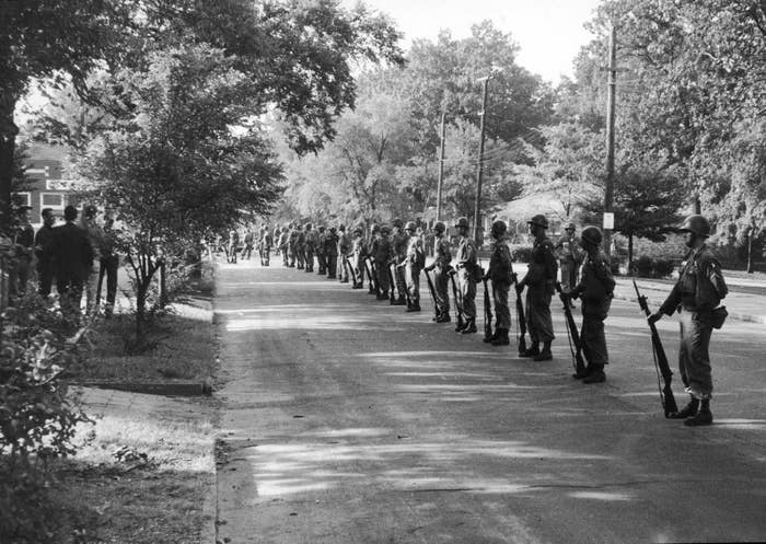US Army troops form a line in a street to enforce the desegregation of Central High School in 1957.