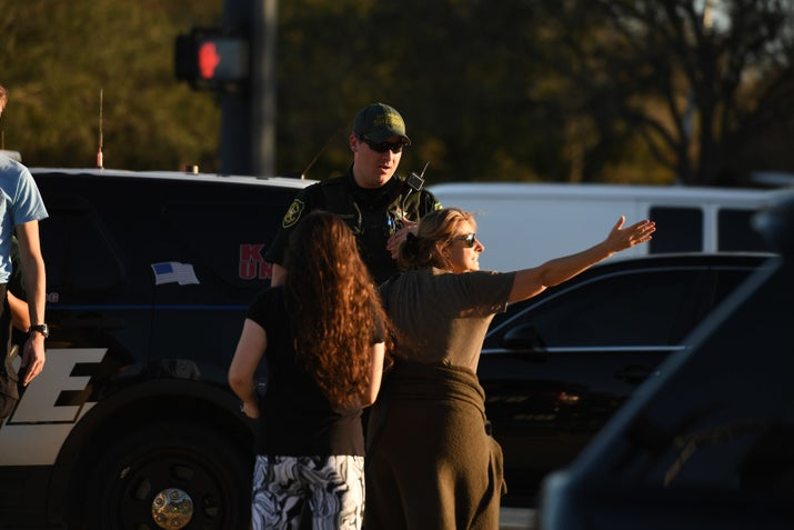 Worried parents question law enforcement officers outside Marjory Stoneman Douglas High School in South Florida following a school shooting that left at least 17 people dead Wednesday.