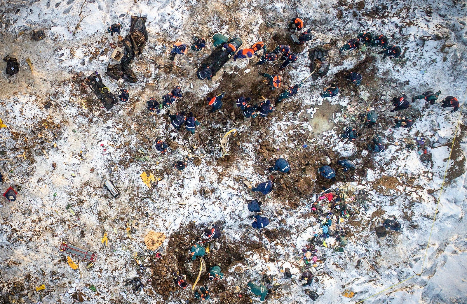 An aerial picture, taken in the Ramensky district on the outskirts of Moscow on Feb. 12, shows emergency rescuers working at the site where a plane crashed the day before. Rescuers searched through deep snow for body parts and debris after a Russian passenger plane crashed near Moscow minutes after takeoff, killing all 71 people on board, in the country's deadliest air crash since 2016.