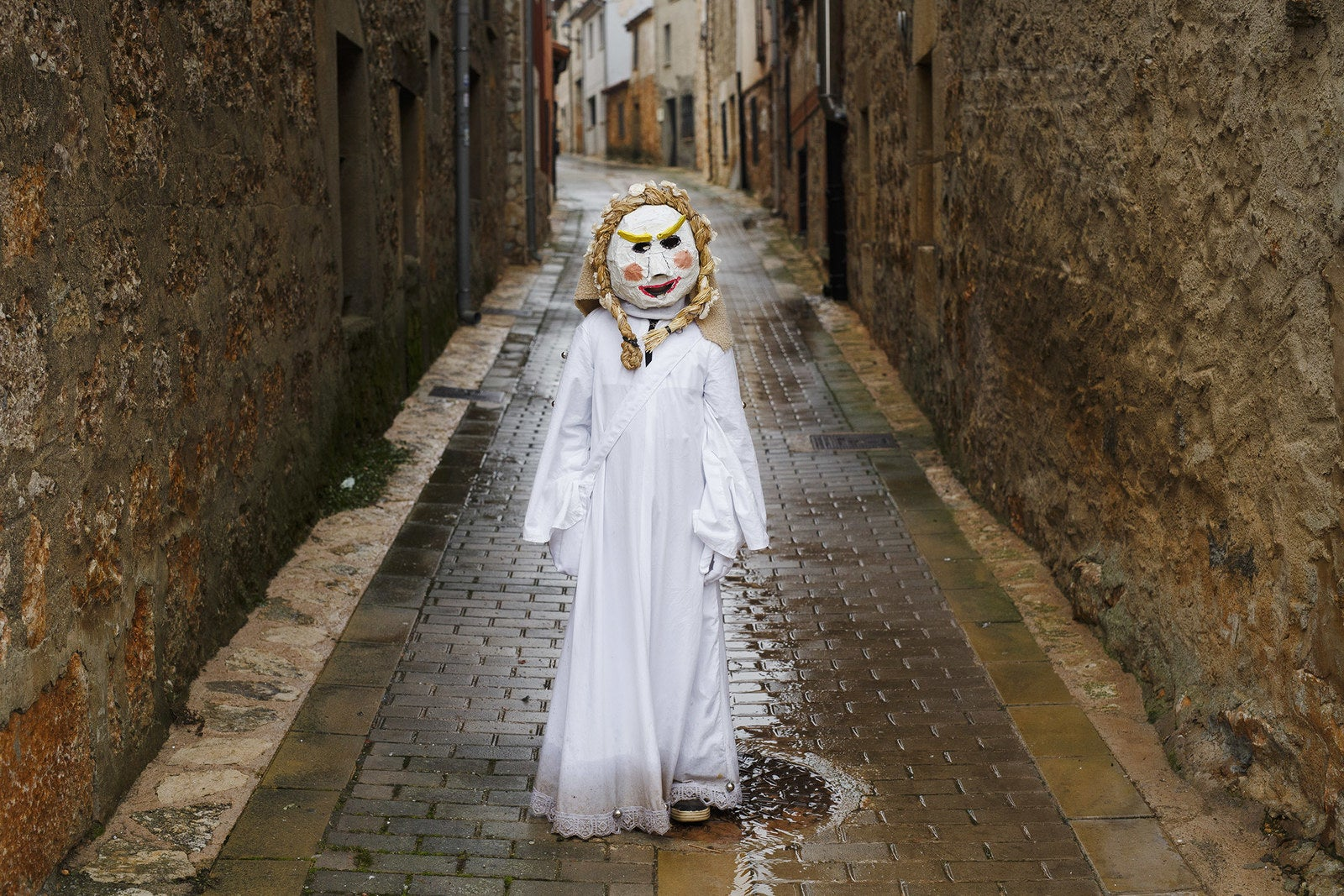 A reveler dressed as a child poses for pictures during El Gallo de Carnaval, or the Rooster Carnival, on Feb. 11 in Mecerreyes, Spain. During the Carnavaladas y Zarramacadas, people take to the streets in costumes made with ropes, bones, skins, scraps of cloth, oak leaves, and other rural items.