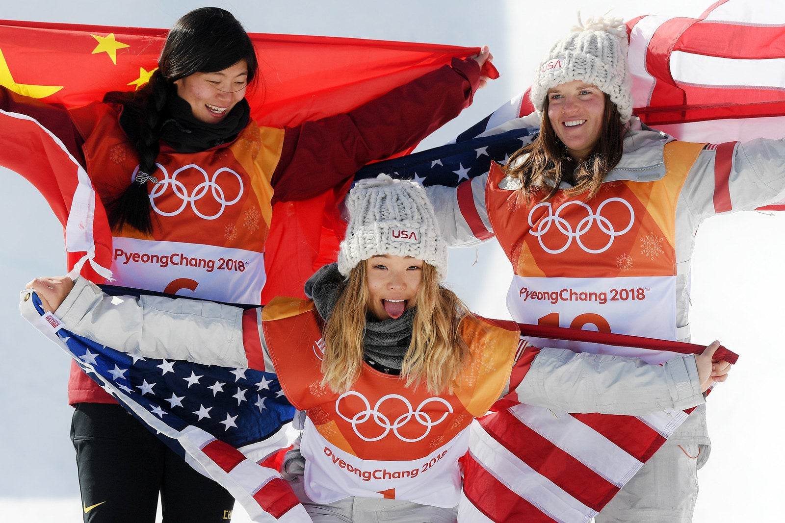 From left: Silver medalist Jiayu Liu of China, gold medalist Chloe Kim of the United States, and bronze medalist Arielle Gold of the United States pose during the victory ceremony for the Snowboard Ladies' Halfpipe Final on day four of the PyeongChang 2018 Winter Olympic Games on Feb. 13, in Pyeongchang-gun, South Korea.